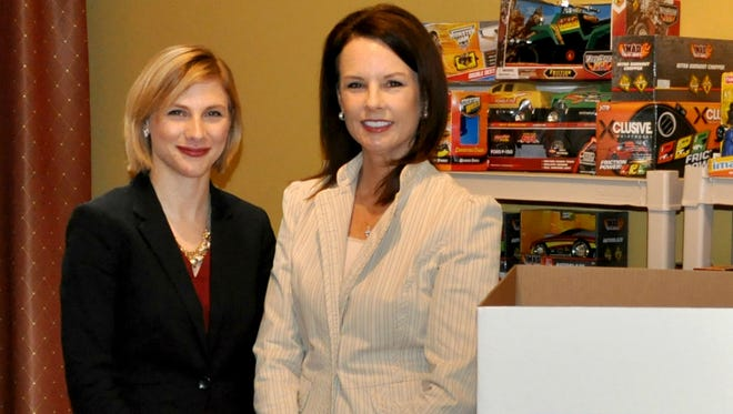 Tabitha Hodges (left), Volunteers of America's community engagement manager, and Jennifer Hancock, Volunteers of America's president and CEO, in the Hope for the Holidays shop.