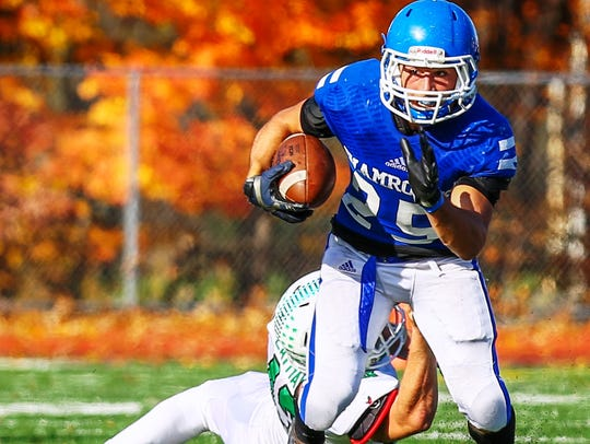 Catholic Central's Nicholas Capatina (with ball) breaks