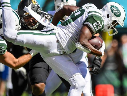 New York Jets running back Bilal Powell avoids all