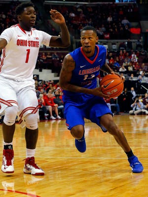 Louisiana Tech Bulldogs guard Jacobi Boykins (13) drives past Ohio State Buckeyes forward Jae'Sean Tate (1) during the second half at Value City Arena. Louisiana Tech won the game 82-74. Mandatory Credit: Russell LaBounty-USA TODAY Sports