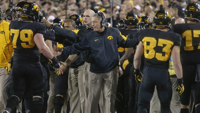 Iowa head football coach Kirk Ferentz celebrates a touchdown with his players against Minnesota on Saturday, Nov. 14, 2015, at Kinnick Stadium in Iowa City.