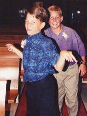 Paul Rust and his friend goof around.