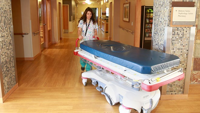 Carla Brown, a radiology transporter, walks through the newly remodeled second floor at San Juan Regional Medical Center in Farmington on Friday.
