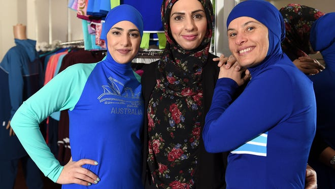 Muslim models display burkini swimsuits at a shop in western Sydney on Aug. 19, 2016.