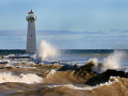 Heavy waves pound the shore at Sodus Point in Wayne County.  The strong waves could cause more flood damage to residents along the Lake Ontario shoreline.