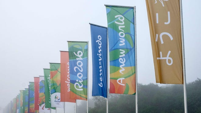 """Flags with the logo of Rio 2016 Olympic and Paralympic Games among others reading """"Welcome"""" in different languages are view near Antonio Carlos Jobim (Galeao) International Airport in Rio de Janeiro, Brazil."""