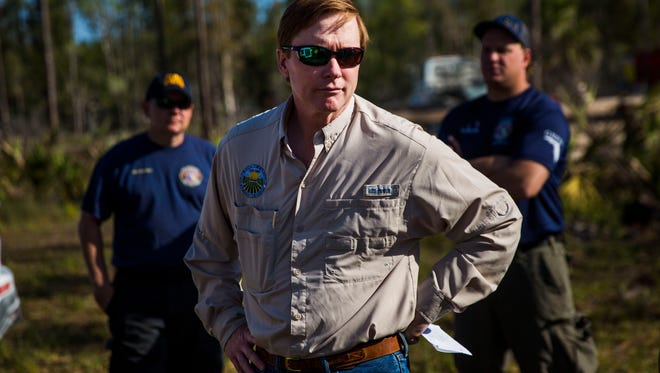 Florida Commissioner of Agriculture Adam Putnam listens to an update on the Greenway Fire at the command post on Wednesday, March 28, 2018, on Sabal Palm Road in eastern Collier County.