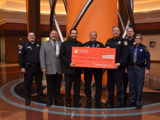 Firekeepers Casino and Hotel presented a $5,000 check