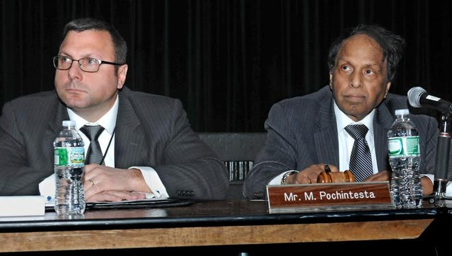 Wappingers Superintendent Marco Pochintesta, left, and school board President Ved Shravah listen to speakers from the audience Monday.