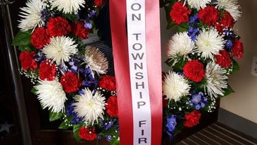 Wreath from Lyon Township Fire Department placed at Tomb of the Unknowns