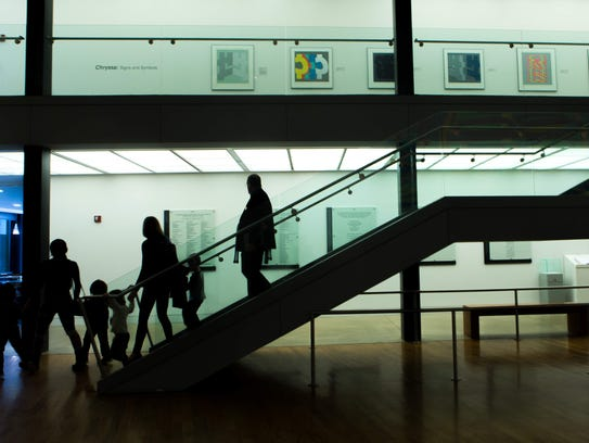 Visitors roam around the Delaware Art Museum, which
