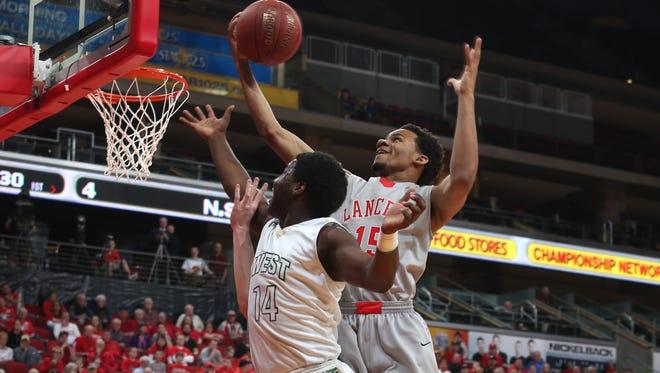 North Scott senior Cortez Seales pulls in a rebound over West High sophomore Devontae Lane during their state basketball game on Friday at Wells Fargo Arena in Des Moines. North Scott won the game 57-51.