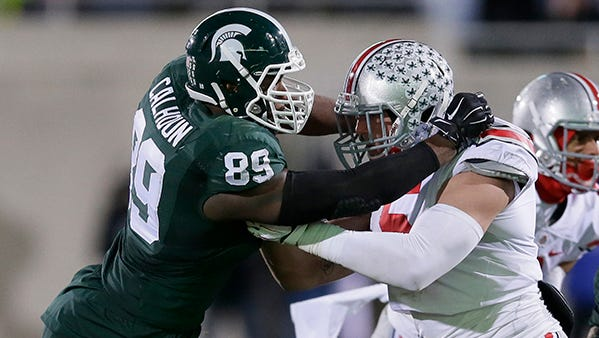 Shilique Calhoun rushes the Ohio State line during last year's MSU-OSU game, won by the Buckeyes, 49-37.