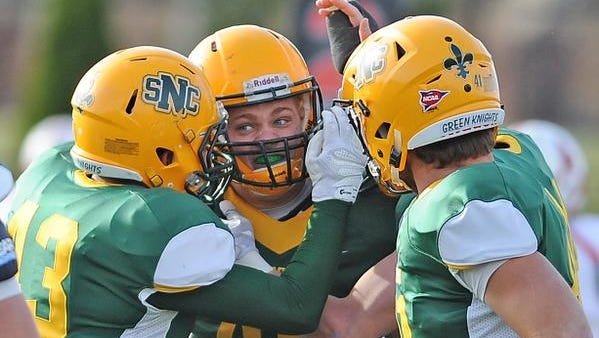 St. Norbert College linebacker R.J. Callow (40) is pretty pumped after making an interception against Monmouth College in the Midwest Conference Championship game at Schneider Stadium November 14, 2015.