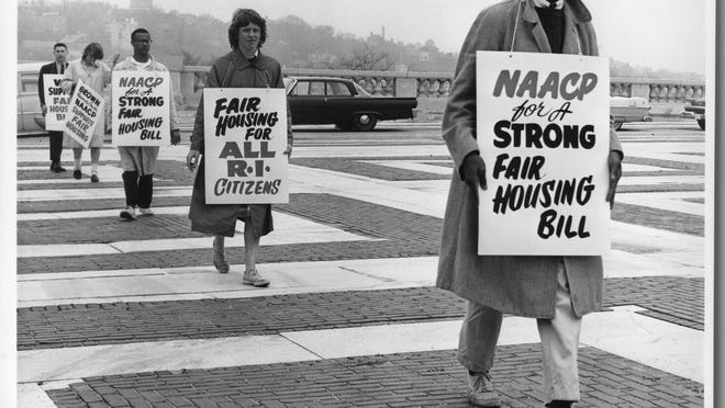 Members of the Brown University chapter of the NAACP picket outside the State House in May 1961 to support passage of the Citizens United bill for fair housing.