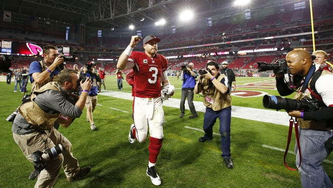 Arizona Cardinals' Carson Palmer celebrates after defeating the Green Bay Packers 38-8 on Dec. 27, 2015 in Glendale, Ariz.