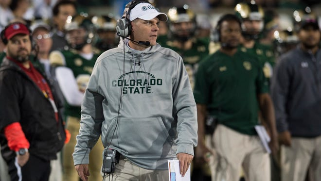 CSU coach Mike Bobo walks the sidelines during the Rams' game against UNLV on Nov. 14 at Hughes Stadium. Yahoo Sports reported that Bobo, who said he would be out of town recruiting this week, interviewed for the Missouri coaching job this week in Denver.