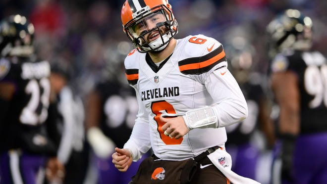 Cleveland Browns quarterback Baker Mayfield reacts after throwing a touchdown pass Sunday against the Baltimore Ravens. Mayfield, the top pick in the 2018 draft, makes the Browns an attractive option for coaches.