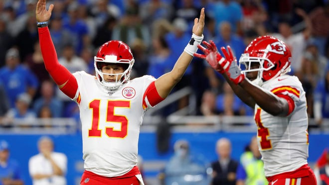 Kansas City Chiefs quarterback Patrick Mahomes II (15) reacts after a touchdown during the first half of an NFL football game Sept. 29, 2019 against the Detroit Lions in Detroit. The Chiefs have agreed to a 10-year contract extension with Super Bowl MVP Mahomes keeping him around through 2031. AP Photo/Paul Sancya]