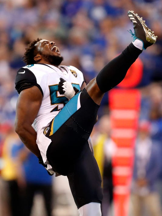 Jacksonville Jaguars defensive end Dante Fowler celebrates a sack against the Indianapolis Colts during the second half of an NFL football game in Indianapolis, Sunday, Oct. 22, 2017. (AP Photo/Jeff Roberson)