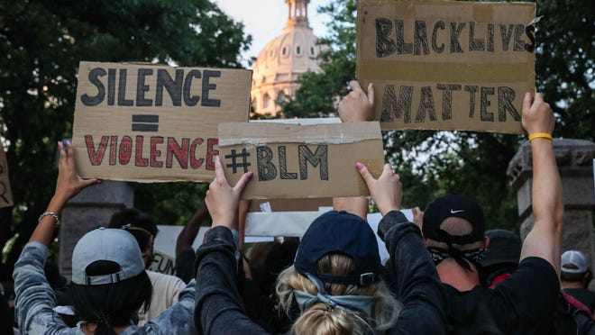 A group of protesters gather at the entrance of Texas State Capitol decrying the death of George Floyd and police brutality against black Americans in Austin on Tuesday, June 2, 2020.