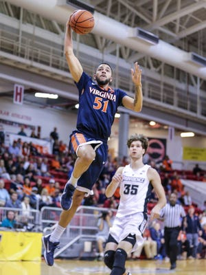 Virginia guard Darius Thompson (51) goes up to dunk the ball in front of Providence guard Ryan Fazekas (35) during the first half.