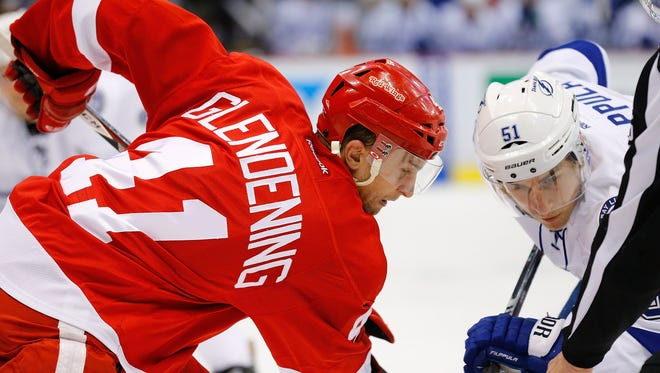 Luke Glendening, left, of the Detroit Red Wings and Valtteri Filppula of the Tampa Bay Lightning face off during Game 3 on Tuesday, April 21, 2015, at Joe Louis Arena in Detroit.