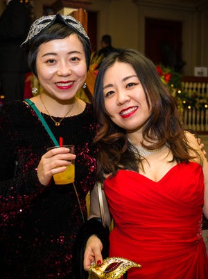 Lulu Sun and Elaine Ji welcomed 2018 at Masquerade in the Mansion at the Roberson Museum on New Year's Eve.