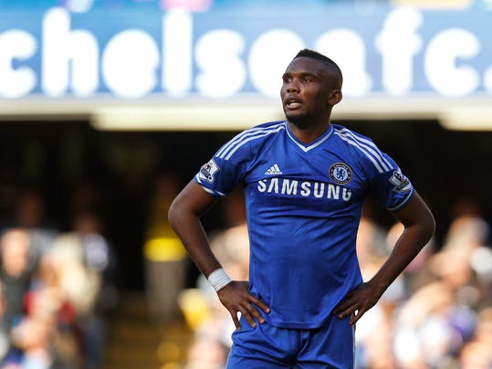 FILE - A Saturday, April 19, 2014 photo from files showing Chelsea's Samuel Eto'o reacting to a decision by the referee Mike Dean, during an English Premier League soccer match against Sunderland at the Stamford Bridge ground in London. Everton strengthened its attacking options by signing Samuel Eto'o on a two-year deal on Tuesday, Aug. 26, 2014, after the striker was released by Premier League rival Chelsea. The 33-year-old Cameroon international, who scored 12 goals in 35 matches in his only season at Chelsea, is available to make his debut against the west London club on Saturday.  (AP Photo/Lefteris Pitarakis, File)