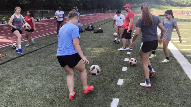 First-year Van Horn girls soccer head coach Zach Wilson, who has previously served as the assistant girls and boys coach, watches his team warm up before a Thursday morning practice session at the high school.