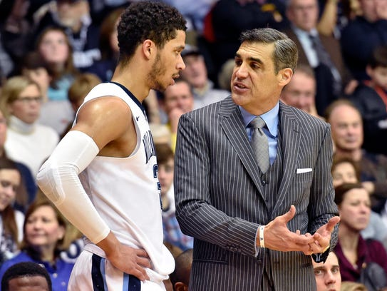 Villanova Wildcats coach Jay Wright talks with guard