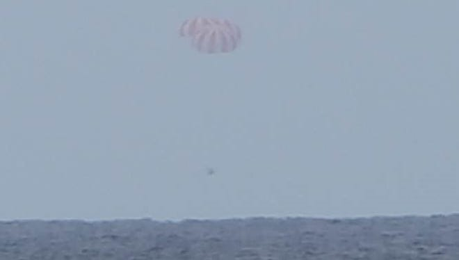 An unmanned SpaceX Dragon cargo capsule splashes down in the Pacific Ocean on Friday to complete its return home from the International Space Station.