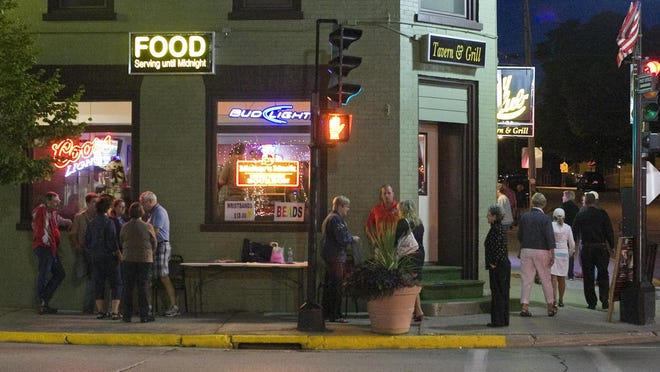 People mingle outside the City Club during a previous Cheese Capital Jazz Crawl for the Arts in Plymouth.