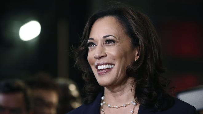 Democratic presidential candidate Sen. Kamala Harris, D-Calif., listens to questions after the Democratic primary debate hosted by NBC News at the Adrienne Arsht Center for the Performing Art in Miami.