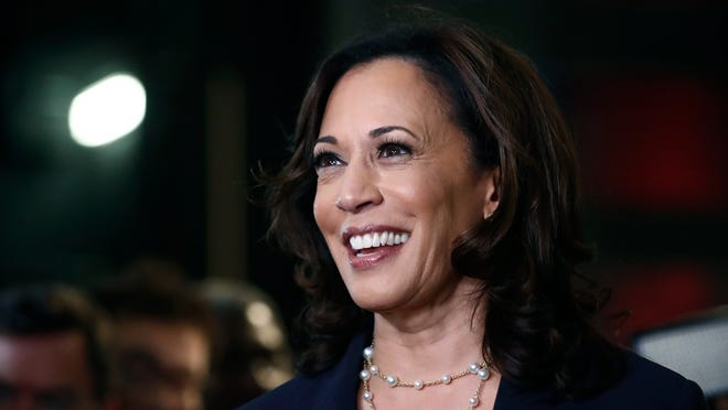 FILE - In this June 27, 2019, file photo, then-Democratic presidential candidate Sen. Kamala Harris, D-Calif., listens to questions after the Democratic primary debate hosted by NBC News at the Adrienne Arsht Center for the Performing Art in Miami.