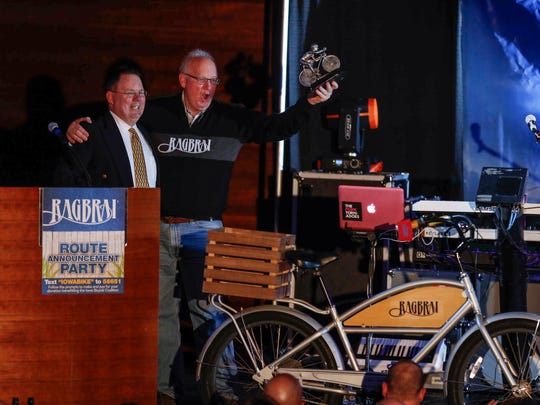 RAGBRAI director T.J. Juskiewicz presents Rich Ketcham with an award during the RAGBRAI route announcement party on Saturday, Jan. 27, 2018, at the Iowa Events Center.