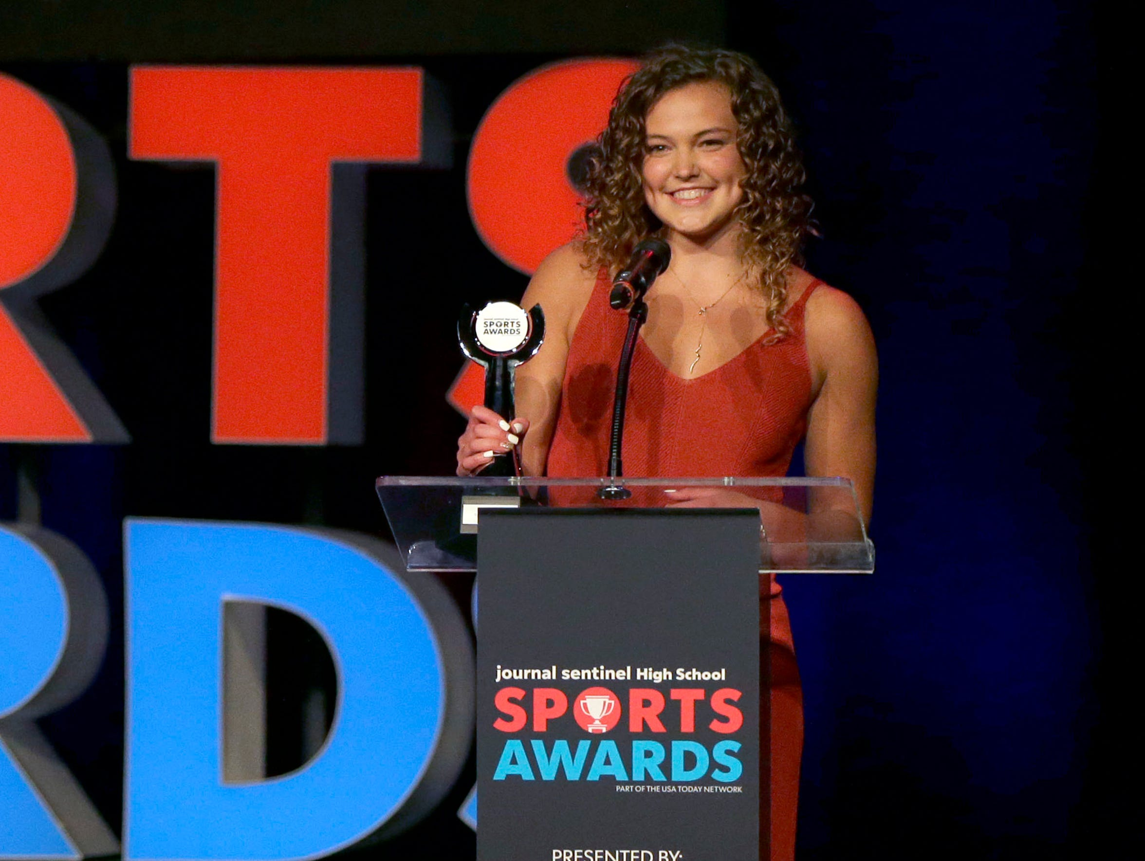 Arrowhead's Lexi Woida accepts the gymnastics athlete of the year award at the Journal Sentinel Sports Awards in May.