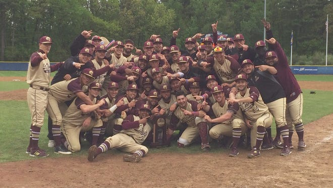 St. Thomas Aquinas' baseball team poses after winning the NCAA Division-II East Regional title on Monday in Manchester, New Hampshire