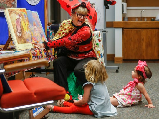 Joyce Tolliver reads the first story she ever read 15 years ago during Storytime with Ms. Ladybug at the Springfield Conservation Nature Center on Wednesday, May 9, 2018.