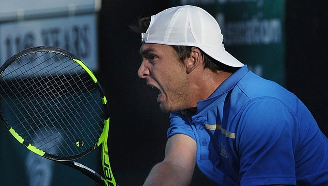 Martin Redlicki of UCLA hits a return against UC Berkeley in a 2016 Pac-12 Men's Tennis Championship doubles match at The Ojai Tennis Tournament. UCLA is among the favorites to win the men's team title again this year.