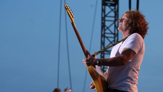 Guitarist Scotty Johnson and the Gin Blossoms, pictured performing at the Stone Pony Summer Stage in Asbury Park in 2013, play the Wellmont Theater in Montclair on Saturday night.