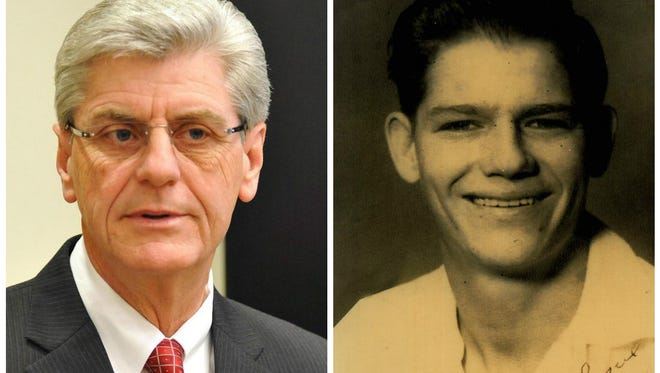 Governor Phil Bryant (left), Army Cpl. Dudley Evans