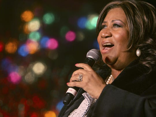 Aretha Franklin performs during the 85th annual Christmas tree lighting at the New York Stock Exchange in New York in December 2008.