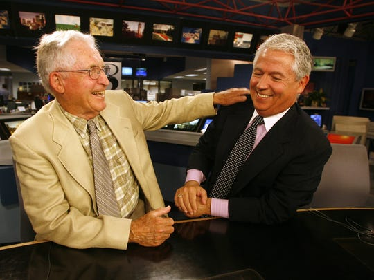 Longtime Des Moines Tribune newsman Jim Cooney, left, and son Kevin Cooney.