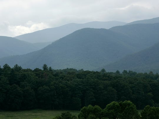 Haze shrouds the ridges above Cades Cove, a broad,