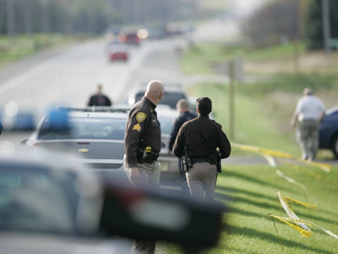 Officials investigate the area outside the Greenville