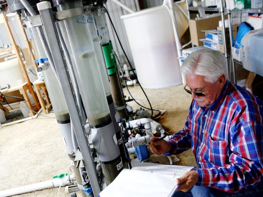 Ron Ruiz, then-superintendent of City of San Angelo Water Quality, writes down the readings of pressure and flow from the columns of water being filtered from a Hickory Aquifer pilot project in 2010.