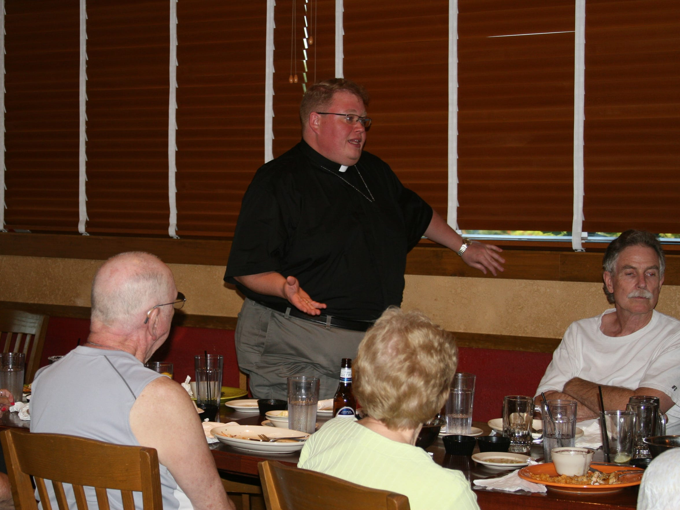 Father Kevin Gore talks to his congregants during his first Pub Theology group on Aug. 1 at El Chico's. Father Kevin joined from St. Andrew's Episcopal Church on July 1 of this year and is continuing the Pub Theology tradition that was started at the church.