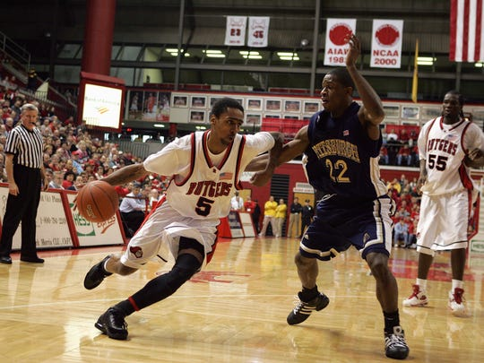 Quincy Douby moves the ball against Antonio Graves