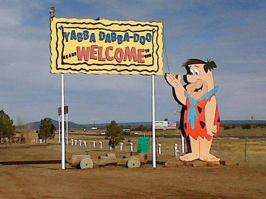 The welcome sign at Bedrock City in Valle. The new owners of the Flintstones' hometown are turning the park into Raptor Ranch, offering exhibits and displays of birds of prey.